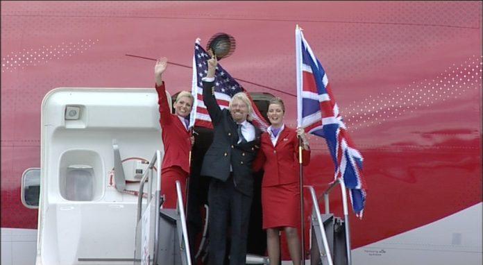 Sir Richard Branson waves